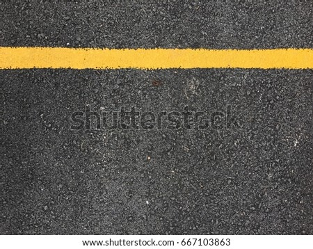 Yellow paint line on black asphalt road surface texture. space transportation background #667103863