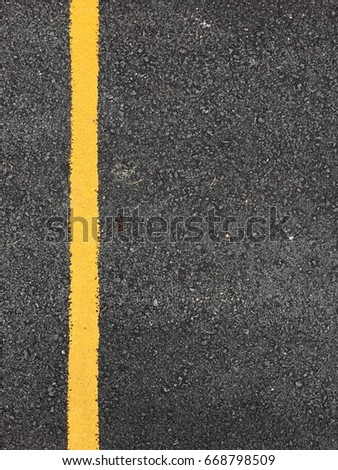 Yellow paint line on black asphalt road surface texture. space transportation background #668798509