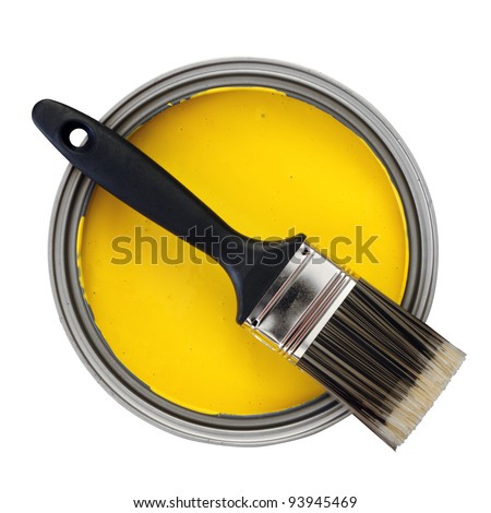 yellow paint with paint brush over white background