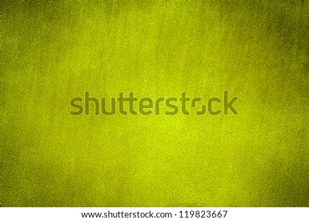 Yellow painted metal plate background texture. Dark edged