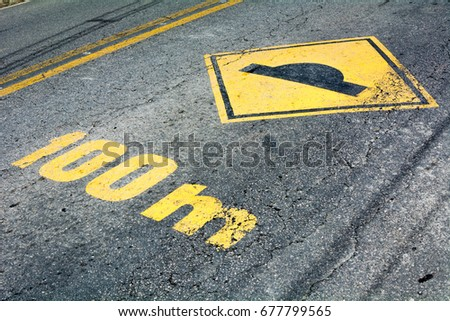 Yellow painted street signaling spine sign #677799565
