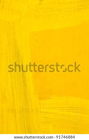 Yellow painted wall with brushstroke textured