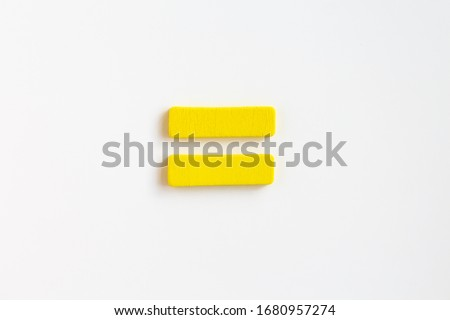yellow painted wooden equal, craft sign for kid's education isolated, ecological concept Stock photo ©