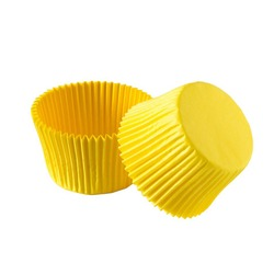 Yellow paper cupcake forms for baking isolated over white background, muffin forms object photography, confectionery baking forms clipart