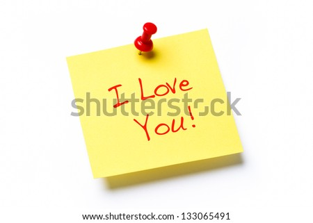 Yellow paper note with the words I Love You, isolated on a white background