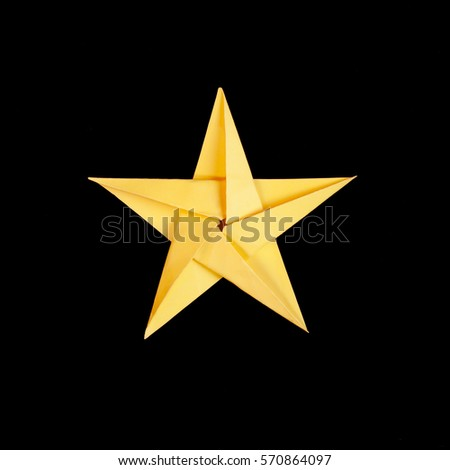 Yellow Paper Origami Star On Black Background #570864097