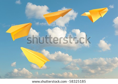 Yellow paper planes flying