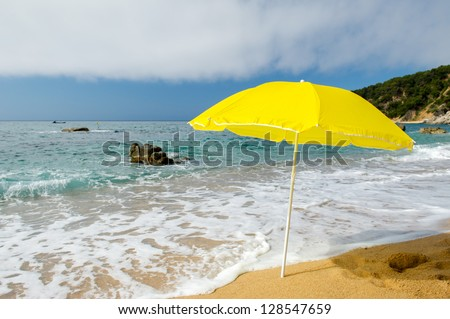 yellow parasol at the summer beach
