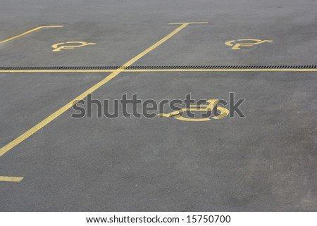 Yellow parking sign for handicaped people