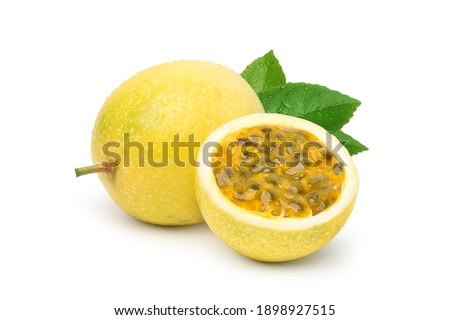 Yellow  passion fruit with cut in half and green leaf isolated on white background.