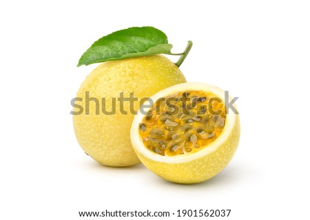 Yellow  passion fruit with cut in half and green leaf isolated on white background. Clipping path.