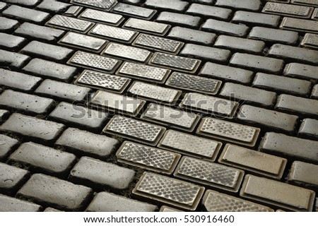 Yellow paving stone background on city street #530916460