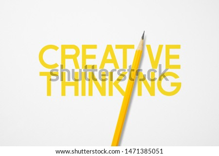 Yellow pencil photo composition interacting replace to i of creative thinking words to use for presentation about education, business or creativity. Smooth lighting on pencil in studio.3d illustration