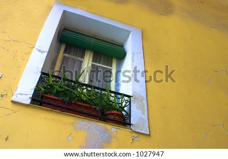 Yellow picturesque wall with a window