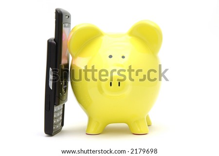 Yellow piggy bank talking on phone in isolated white background - stock photo