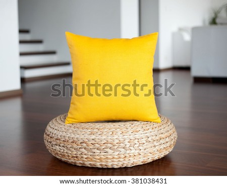 Yellow  pillow in white interior. Decorative yellow pillow in interior as bright accent.