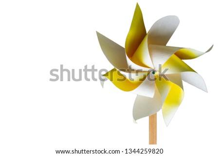 Yellow pinwheel isolated #1344259820