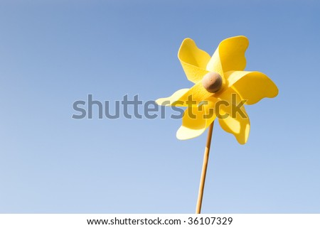 yellow pinwheel on clear blue sky