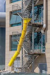 Yellow Plastic Debris Chute at Building Construction Site