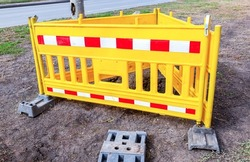 Yellow plastic fence at construction site. Road works traffic sign at the city street