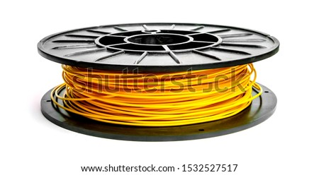 Yellow plastic filament wire for printing on a 3D printer. ABS / PLA plastic in the reel (coil), weight 0.5 kg, thread thickness 1.75 mm.