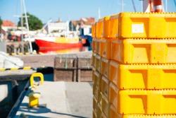 Yellow plastic fish crates on the wharf