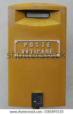 Yellow post box in Vatican City Rome Italy attached to the wall known as  Poste Vaticane