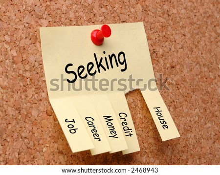 Yellow post-it note with job, career, money, credit, house seeking ad, affixed to the corkboard with red pushpin