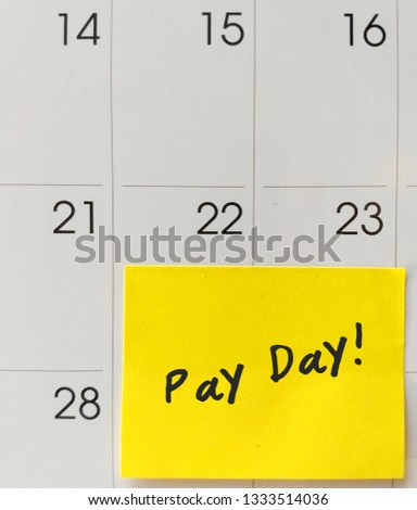 Yellow post-it notepad stick on the end of the month date on calendar, with hand written message PAY DAY ,concept of money saving /financial plan/debt or bill payment/make ends meet #1333514036