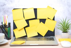 Yellow post note paper, memo paper on a screen laptop computer. scheduled for job or short note for work concept, minimal office desk.
