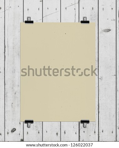yellow poster on a wood wall