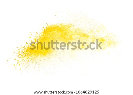 Yellow powder explosion isolated on white background.