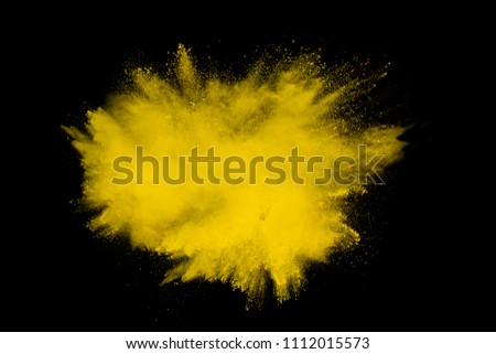 Yellow powder explosion on black background. #1112015573