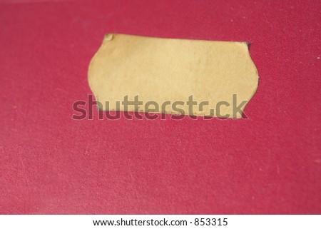 Yellow (price) sticker on a red background