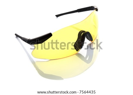 Yellow protective sunglasses isolated on white background with light reflection.