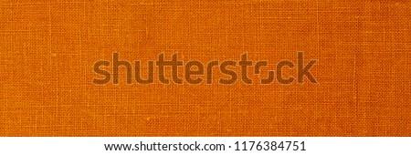 Yellow pure linen fabric background. ochre pure Natural linen texture, banner