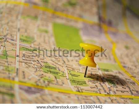 Yellow pushpin on a map