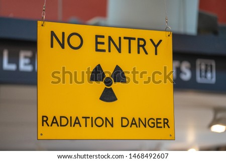 Yellow radiation warning and hazard sign forbidding entry to a radioactive zone