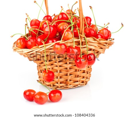 Yellow & red cherries in wicker basket isolated on white background