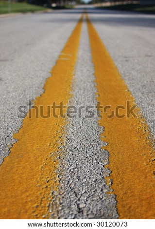 Yellow reflective stripe in center of road