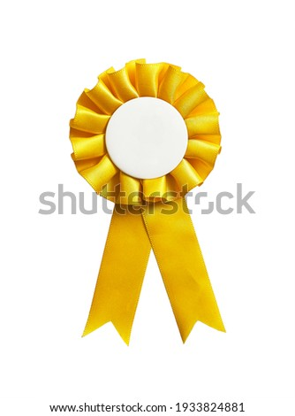 Yellow rosette ribbon with a blank copy space, isolated on a white background. Stockfoto ©
