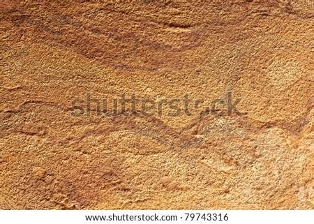 Yellow rough stone texture closeup horizontal background