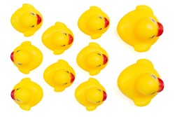 Yellow rubber ducks in a row. An individualist is sticking out the crowd