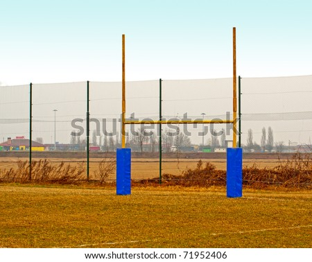Yellow rugby poles in a rugby field