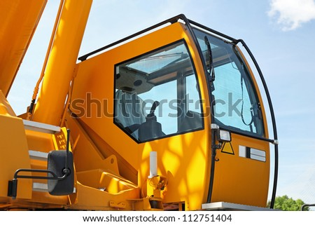 Yellow safety cabin for construction crane operator