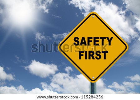 Yellow safety first roadsign