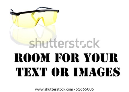 yellow safety glasses on white with reflections with room for your text or images