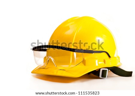Yellow safety helmet and goggles on white background