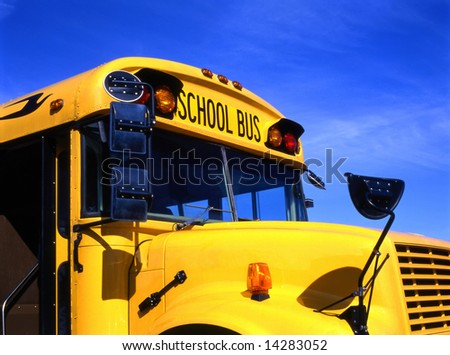 Yellow school bus against blue sky