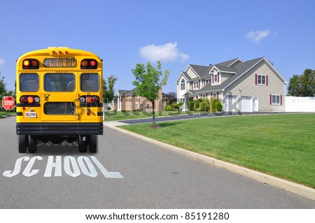 Yellow School Bus on Street in Luxury Suburban Neighborhood